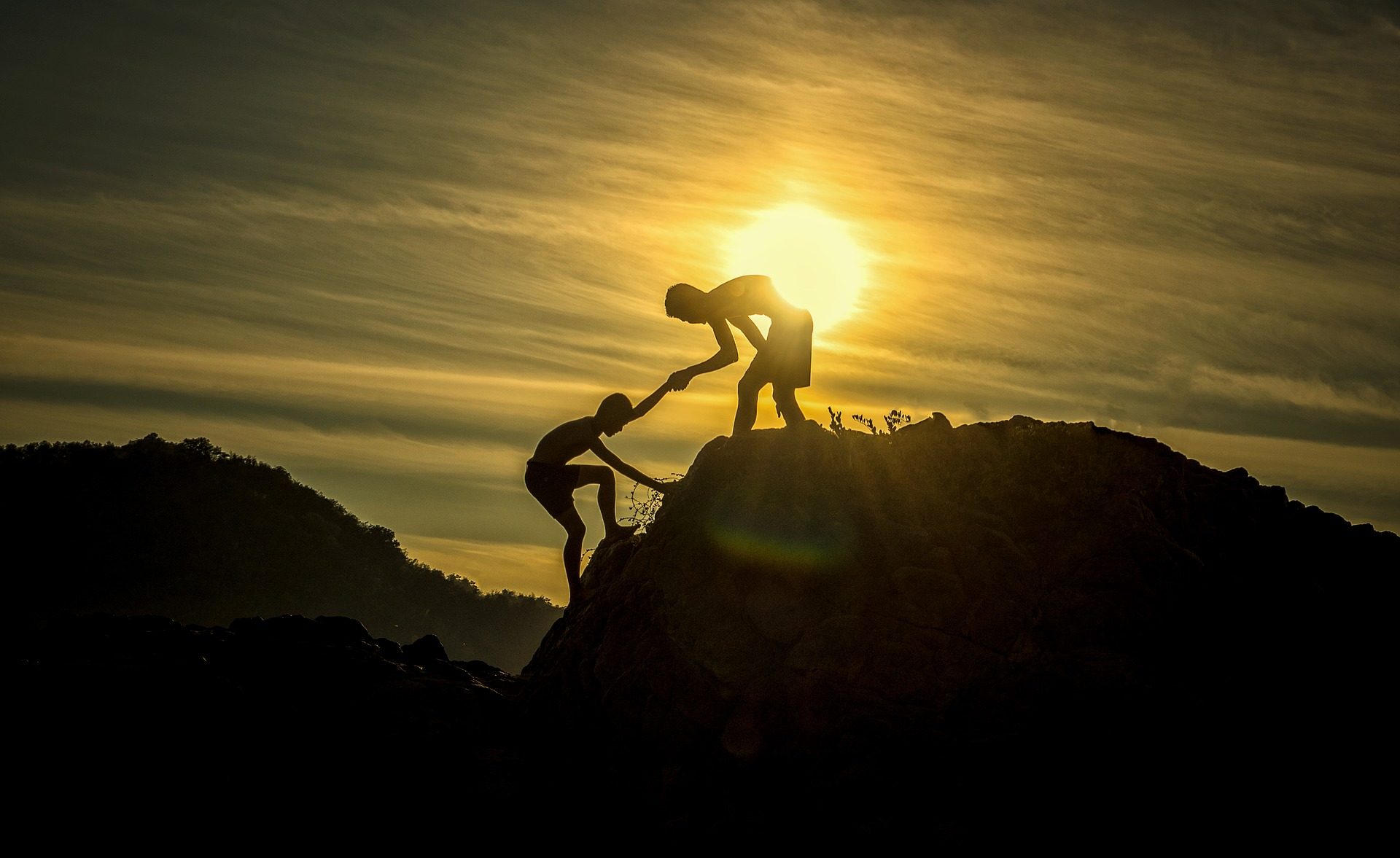 Two people working as a team to achieve